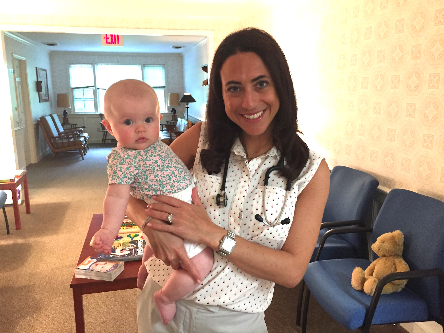 Dr. Nicole A. Panza holds a patient in the office of Pediatric Associates of Westfield, NJ.